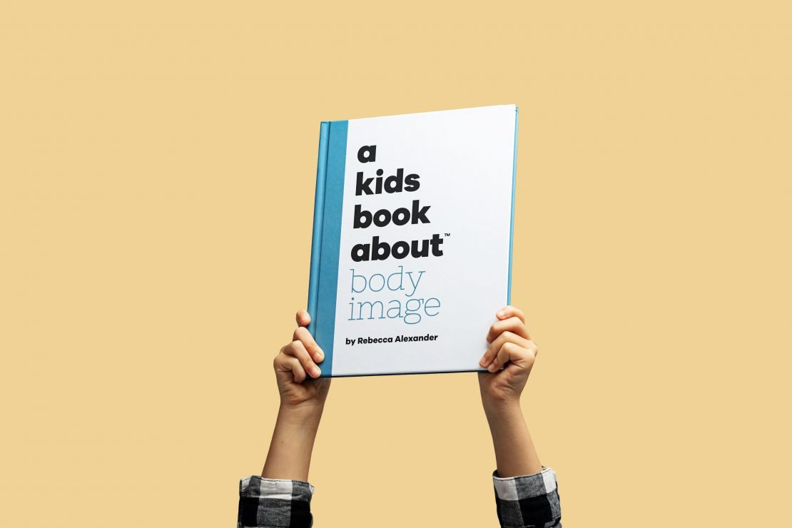 arms holding up A Kids Book About Body Image by Rebecca Alexander